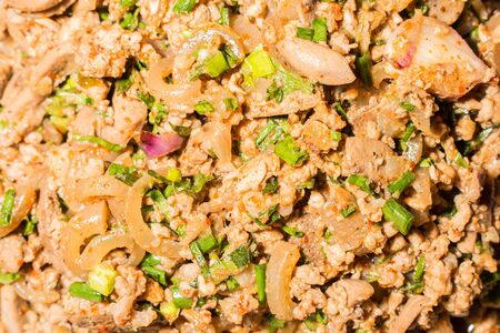 spicy minced pork salad combined with lime juice (larb moo), thai food photo