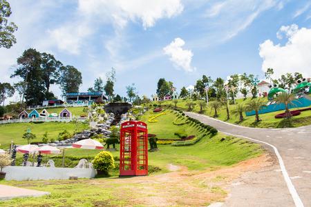 phonebooth: red telephone box in garden of 7 heaven krabi thailand Editorial