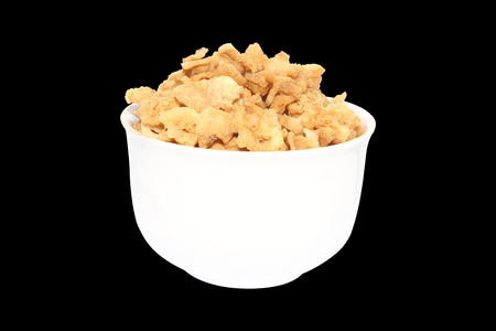 crackling: pork crackling in white bowl on isolated background Stock Photo