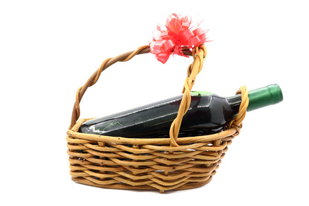 gift basket: wine bottle isolated in gift basket on white background