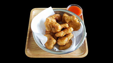 chicken nuggets with clipping part isolated on black background