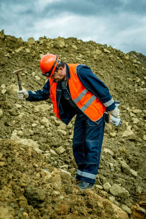 nickel: Geologist hammer breaks nickel ore