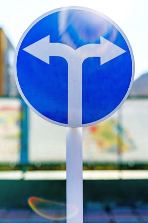 Road sign mandatory direction of travel Stock Photo