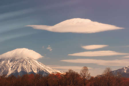 Cloud above volcano at calm autumn day Stock Photo