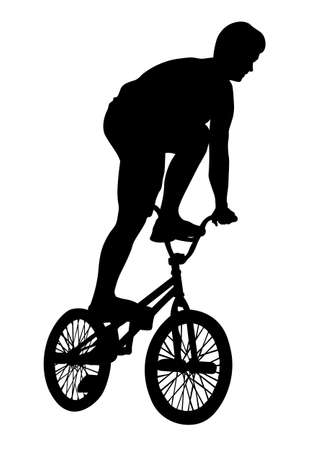 Teenager performs a BMX bike trick silhouette