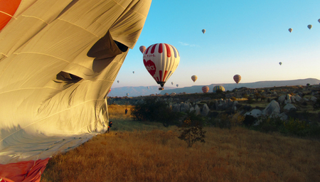 ballooning: Beautiful morning in the meadows of Cappadocia, Turkey, after ballooning, we observed how the baloon was deflated.