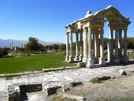 approached: The Monumental Gateway, or Tetrapylon, which greeted pilgrims when they approached the Temple or Sanctuary of Aphrodite, in Aphrodisias, Turkey. Stock Photo