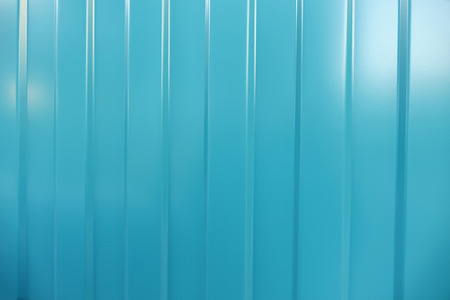 corrugated iron: Corrugated iron is new. Texture color. Background. Background. Building material corrugated iron. It can be used as background for web sites and printing. Also suitable for design. Blue.