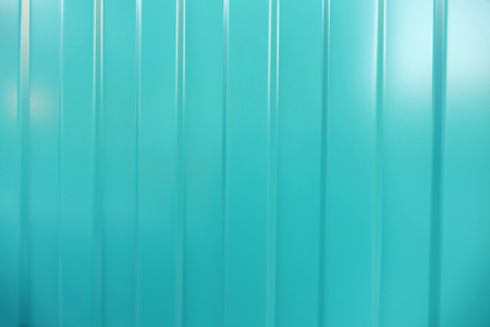 corrugated iron: Corrugated iron is new. Texture color. Background. Background. Building material corrugated iron. It can be used as background for web sites and printing. Also suitable for design. Cyan. Stock Photo