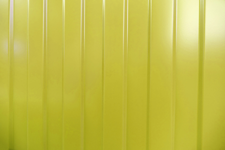 corrugated iron: Corrugated iron is new. Texture color. Background. Background. Building material corrugated iron. It can be used as background for web sites and printing. Also suitable for design. Yellow. Stock Photo