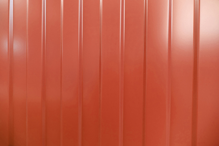 corrugated iron: Corrugated iron is new. Texture color. Background. Background. Building material corrugated iron. It can be used as background for web sites and printing. Also suitable for design. Red.
