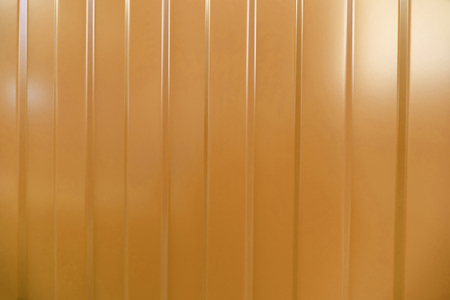 corrugated iron: Corrugated iron is new. Texture color. Background. Background. Building material corrugated iron. It can be used as background for web sites and printing. Also suitable for design. Orange. Stock Photo