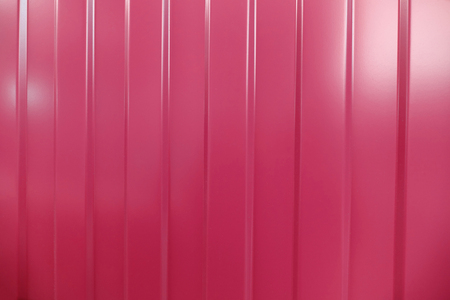 corrugated iron: Corrugated iron is new. Texture color. Background. Background. Building material corrugated iron. It can be used as background for web sites and printing. Also suitable for design. Pink.