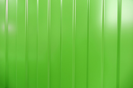 corrugated iron: Corrugated iron is new. Texture color. Background. Background. Building material corrugated iron. It can be used as background for web sites and printing. Also suitable for design.  Green.