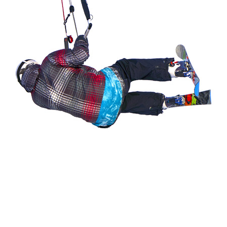 A sportsman practicing snow kiting jumping, isolated on white background. Close-up. Stock Photo