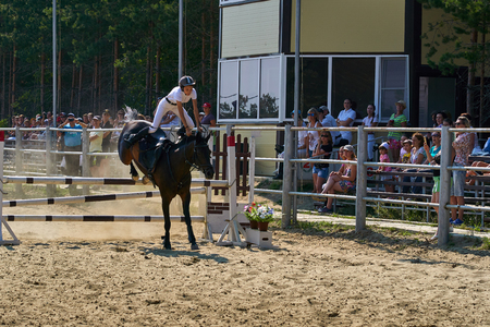 Undory, Ulyanovsk Region, Russia - September 2, 2018: Girl rider riding a horse performs at equestrian competitions. Redactioneel