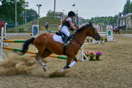 Undory, Ulyanovsk Region, Russia - September 2, 2018: Girl rider riding a horse performs at equestrian competitions. Redakční
