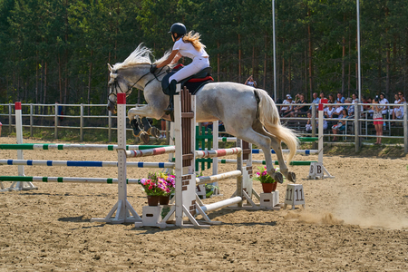 Undory, Ulyanovsk Region, Russia - September 2, 2018: Girl rider riding a horse performs at equestrian competitions. 에디토리얼