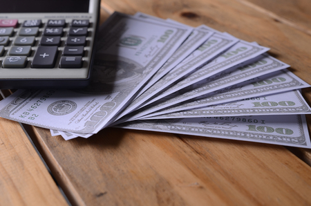 A calculator on an  America Dollar Note or money background, business concept