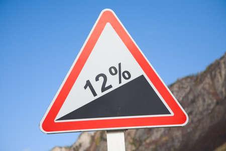 Road grade 12 per cent, road sign photo