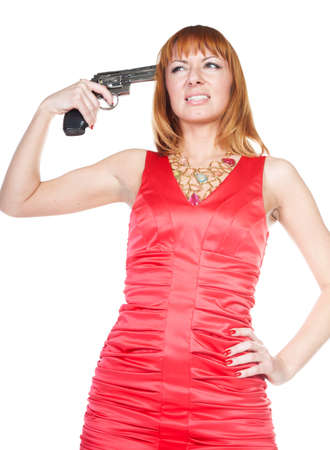 Woman in red dress shoots himself in the head with a revolver Stock Photo - 12050032