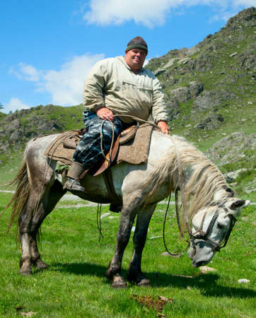Thick dirty man on horseback. What looks like the Sancho Panza photo