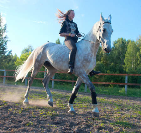 rearing: Girl on a horse without a saddle makes an evening stroll Stock Photo