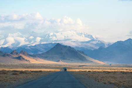 road in the mountains of Mongolia. one of the few asphalt roads Stock Photo