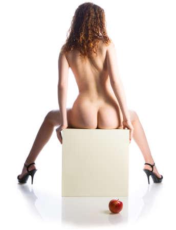 Naked beautiful woman on a white background Stock Photo