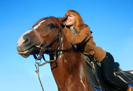 A woman riding a horse in sport photo