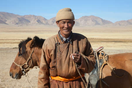 nomad: Nomad with his faithful horse in the steppes of Mongolia