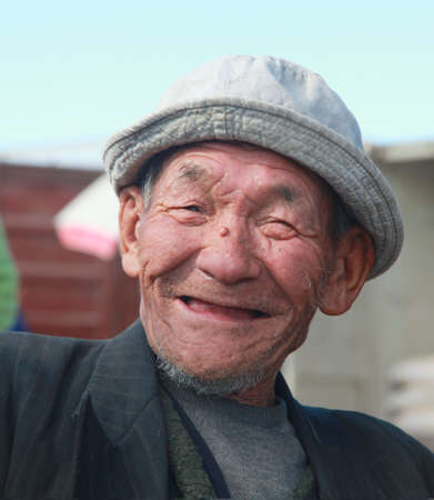The man Mongolian closeup smiling at the camera