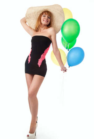 Beautiful woman with balloons in the studio photo