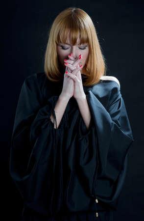 Religious Praying Woman on a black photo