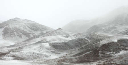 bad weather: Snow and fog in the mountains of northern Mongolia Stock Photo