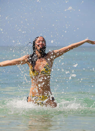 Beautiful girl and a lot of splashing sea Stock Photo - 15983935