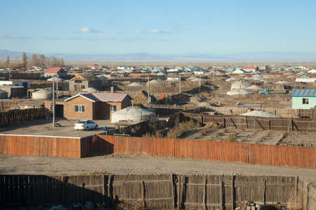 independent mongolia: A typical Mongolian city. Small houses and traditional yurts for the fences Stock Photo