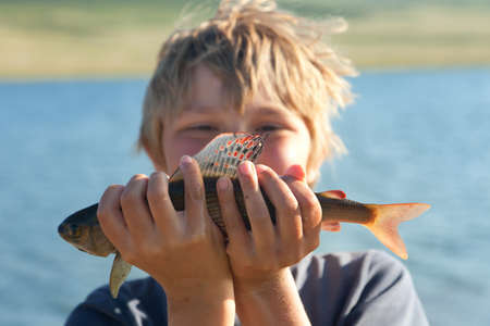 Boy caught grayling and shows all your catch Stock Photo - 16247293