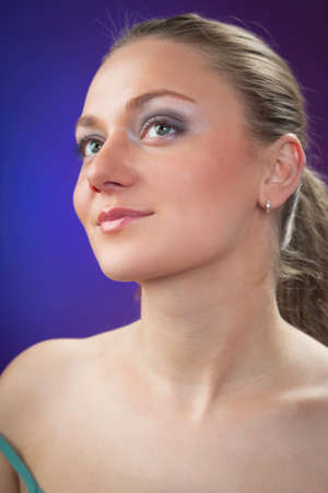 A young beautiful woman on a colored background photo