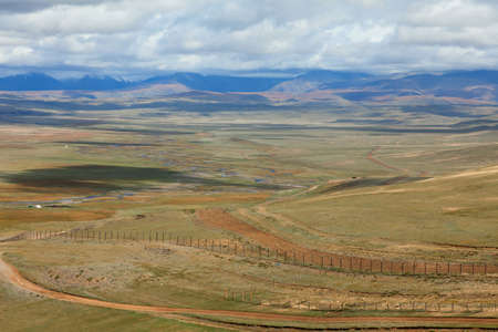 fencing wire: The state border between Rosiey and Mongolia  Stock Photo