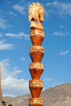 Wooden hitching post. The traditional design of the Altai Stock Photo