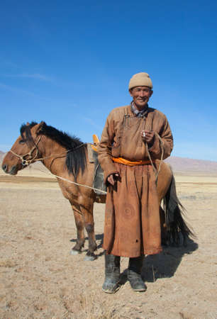 mongolia horse: Nomad with his faithful horse in the steppes of Mongolia