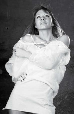 Fashion studio shot of young beautiful woman wearing grey dress  photo