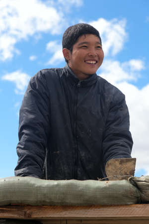 Young Asian workers at a construction site photo