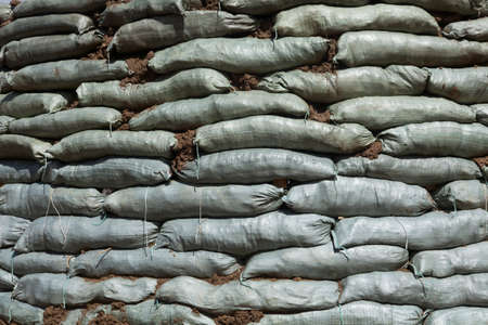 sandbag: Sandbags for flood protection. Temporary dam
