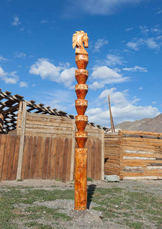 hitching post: Wooden hitching post. The traditional design of the Altai Stock Photo