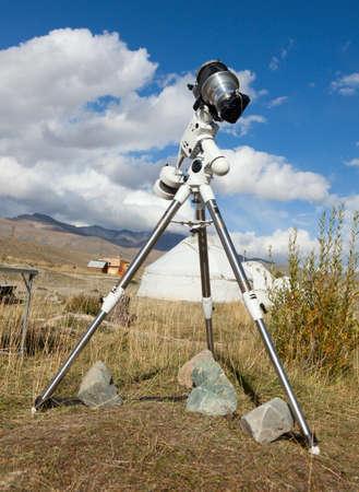 tripod mounted: A single lens reflex camera mounted on a tripod. Stock Photo