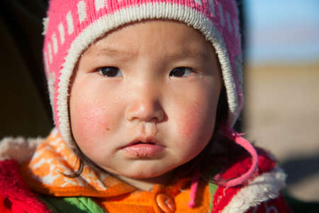 nomad: Mongolian girl is very serious-looking, the daughter of a nomad