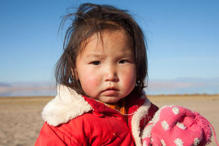 independent mongolia: Mongolian girl is very serious-looking, the daughter of a nomad