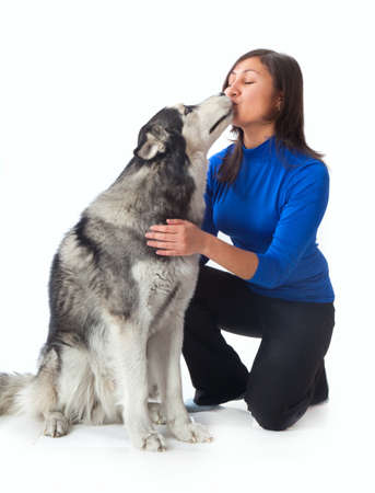 Asian girl and a Siberian husky in the studio photo